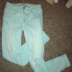 American Eagle turquoise ripped jeans